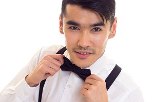 Young man with bow-tie and suspenders