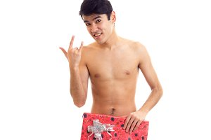 Undressed young man holding present