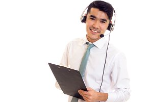 Young man using headphones and holding folder