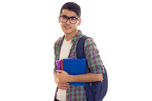 Young man with backpack and books