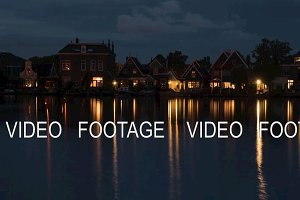 Timelapse of night coming to waterside village in Netherlands