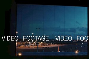Timelapse view of airport runway from night to day time in Amsterdam Airport Schiphol, Netherlands