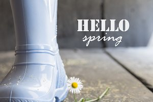 hello spring idea, daisy and boots on a vintage table,