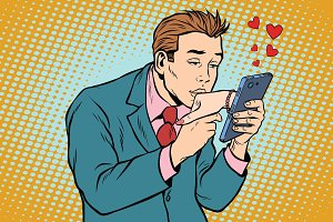 online date and love a man kisses a womans hand via smartphone
