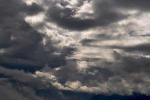 Clouds on dark sky