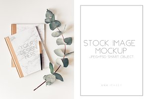 Notepad mockup with eucalyptus.