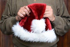 Man Holding Santa Hat