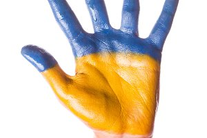 Child's hand in Ukraine colours