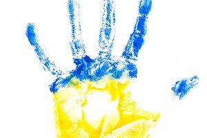 Child's hand imprint in Ukraine colours