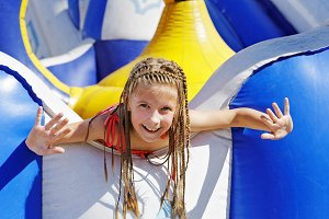 Delighted girl on inflatable attraction