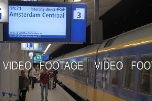 Trains and passengers at railway station of Amsterdam Airport