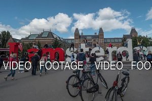 Timelapse of tourists taking pictures at Amsterdam slogan
