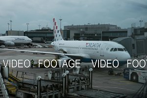 Timelapse view of aircraft in Frankfurt Airport against cloudy sky. Frankfurt am Main, Germany