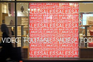 Store front with sale banner illuminated at night