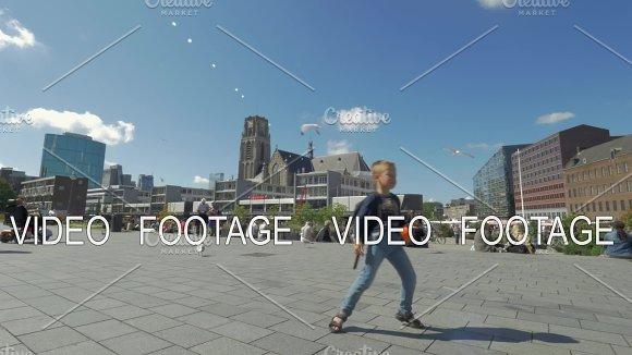 Child having fun and dancing on city street, Rotterdam