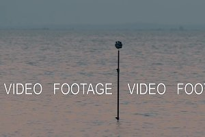 Tripod with cameras shooting 360 degree sea scene