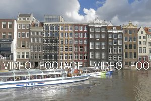 Timelapse of touristic water buses on Amsterdam canal