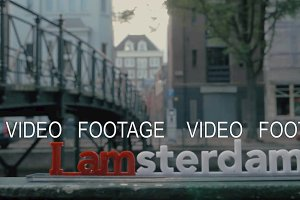 Amsterdam slogan on city background