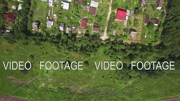 Top view of country houses in sun day at summer, Russia