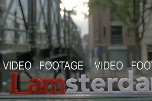 Amsterdam slogan on city view background