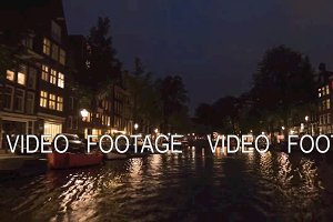 Timelapse of boat tour on Amsterdam canals at night