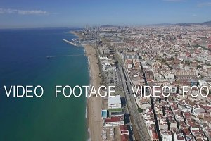 Aerial view of beach, sea, railways and hotels, Barcelona, Spain