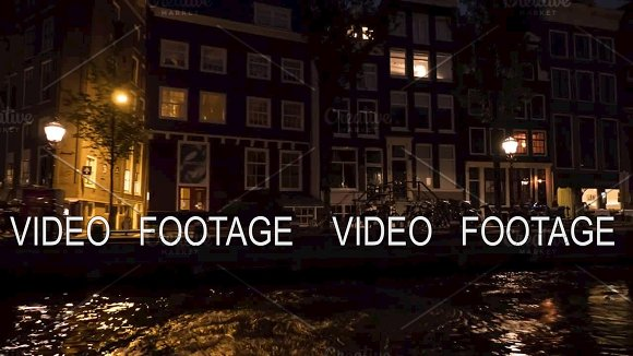 Timelapse View Of Cityscape During River Cruise At Night Amsterdam Netherlands