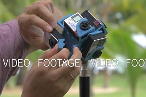 Man fixing six GoPro cameras to make 360 degrees video