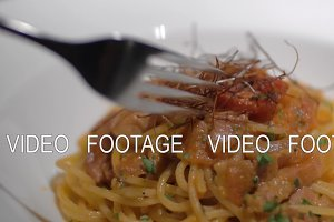 Close-up shot of eating pasta dish in restaurant