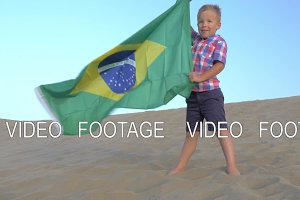Child with Brazilian flag the beach