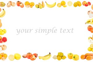 Rectangular frame from different yellow and orange fruits and vegetables