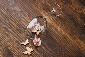 Wineglass with decorative flowers and butterflies