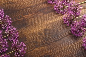 Violet flowers on the wooden board