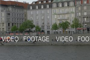 View from boat moving on the Vltava river along Resident Hotel Standard and embankment, Prague, Czech Republic