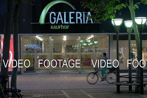 Store front of Galeria Kaufhof and people riding bikes, Frankfurt