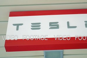 Tesla banner in the store. Automaker of electric cars