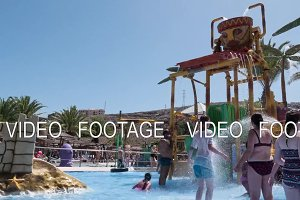 Timelapse of people having fun in water park