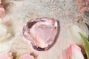 Glass heart, tulips, paper backgrd