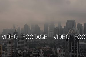 Time lapse view of cityscape with a lot of skyscrapers, constructed buildings against clouds. Kuala Lumpur, Malaysia