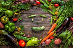 Vegetable smiling face. Fresh organic Vegetables on Wooden table