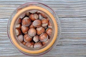 Glass pot with hazelnuts