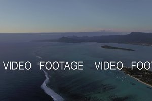 Aerial scene of Mauritius with mountain ranges and blue ocean