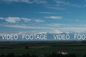 Timelapse view of picturesque landscape with Mount Olympus and countryside against flying clouds in the blue sky, Greece