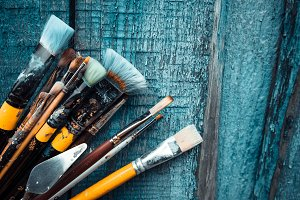 Brushes on wooden background