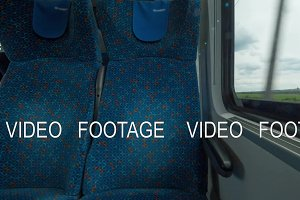 Time lapse shot inside of modern empty train wagon with table, seat places and windows, Vienna, Austria