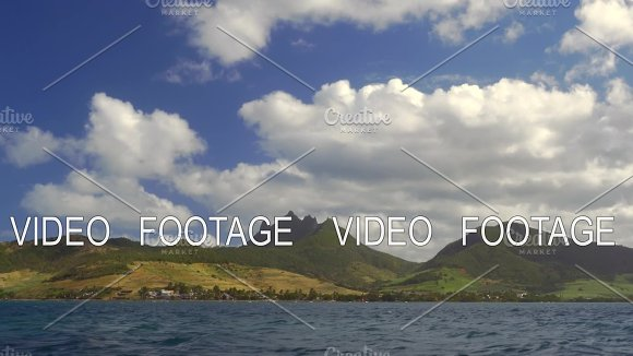 Waterside View Of Green Mauritius Island With Mountains