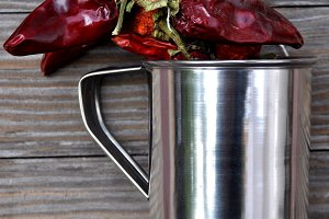 Metal jug and dried peppers