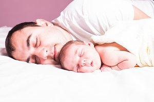 Baby sleeps with dad