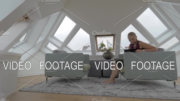 Woman With Pad In The Room Of Cube House