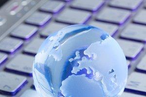 globe on laptop keyboard